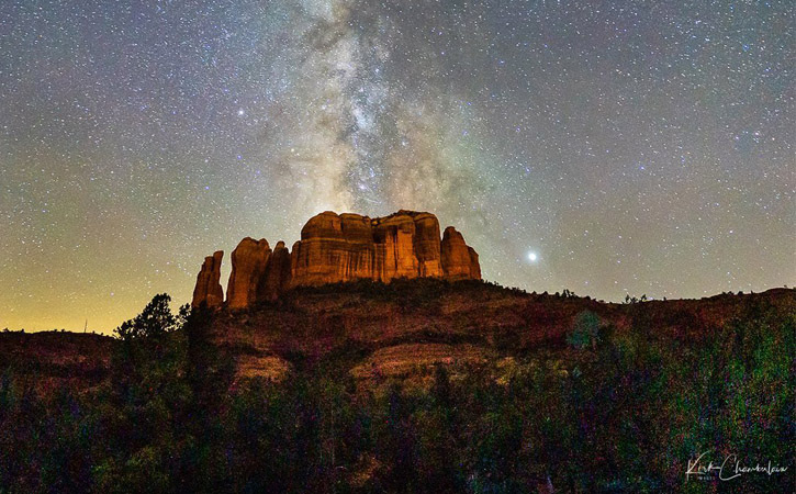 The Milky Way can be seen above a large mountain (Cathedral Rock) in Sedona