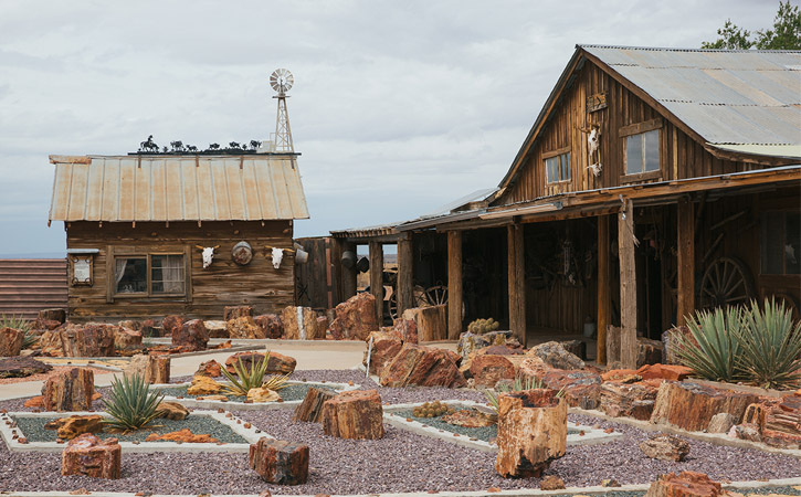 Old West buildings encircle a small garden of petroglyphs on display