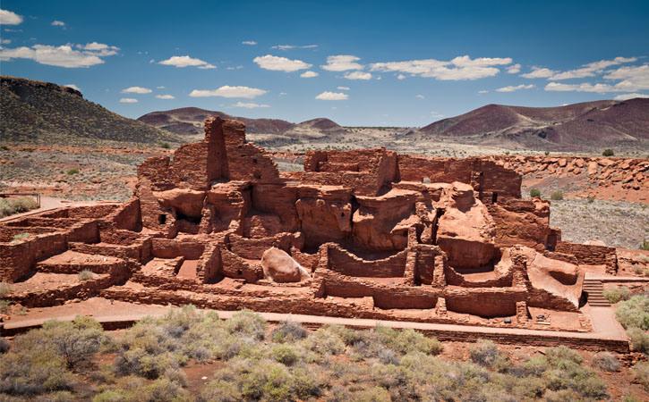 Ancient indigenous ruins stand against a desert landscape