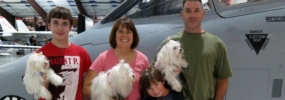 The Saunders family with their dogs at Pima Air and Space Museum near Tucson, Arizona