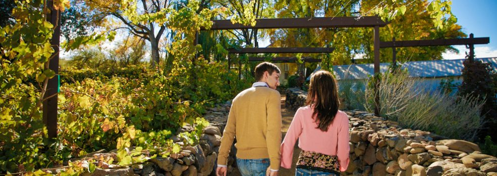 A couple walks through Page Springs Cellars near Cottonwood, Arizona.