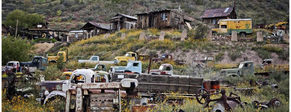 Rusted trucks and old buildings at Gold King Mine and ghost town, taken by Ron Chilston