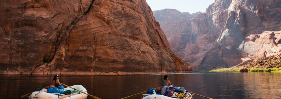 Two women rafting the Colorado River at the bottom of the Grand Canyon