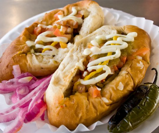 Two Sonoran-style hot dogs from El Guero Canelo restaurant
