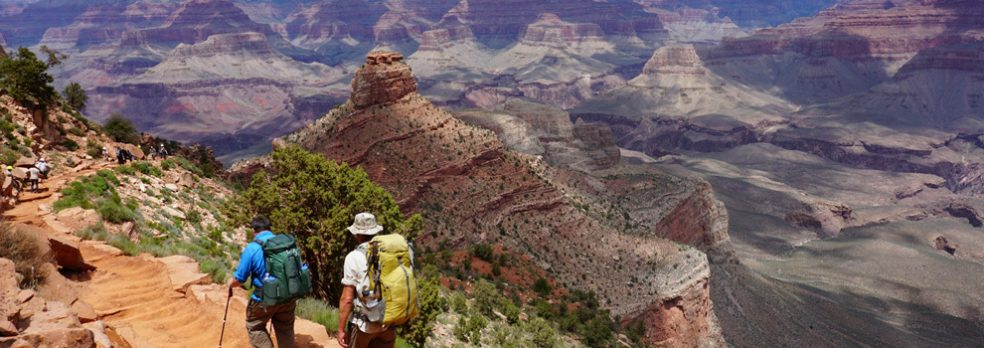 Hikers head down the South Kaibab Trail toward Phantom Ranch in the Grand Canyon