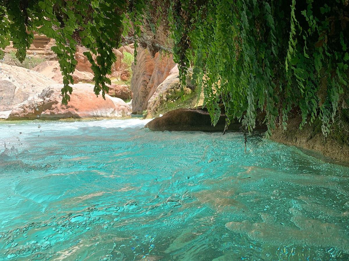 At Havasu Creek hikers can swim in clear aqua pools