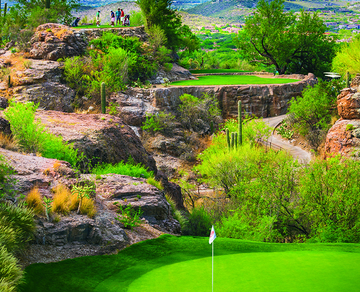 Golfers on the third hole which overlooks the green at The Lodge at Ventana Canyon