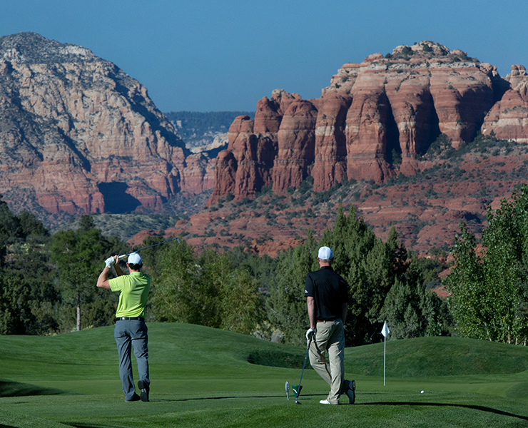 Golfers on the 10th hole of the Sedona Golf Resort with Catheral Rock in the backgound