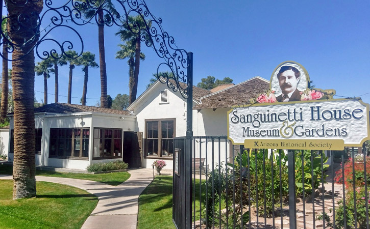 Entrance to a garden and historic home with a sign reading Sanguinetti House Museum and Gardens