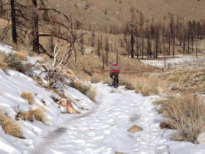 mountain bike on snowy trail. bishop