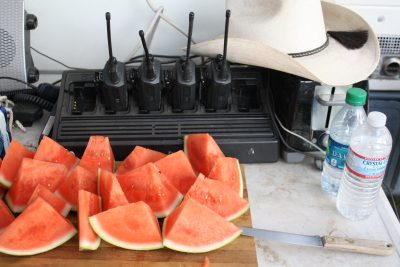 image of hand held radios and watermelon slices