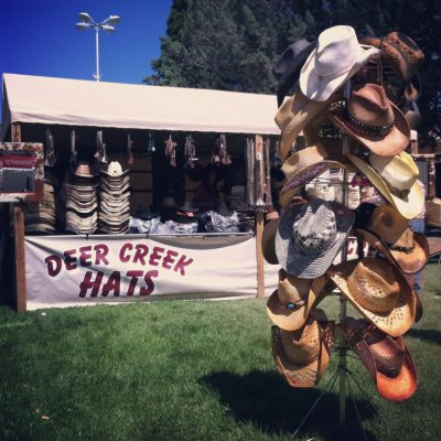 image of a hat vendor with western hats.