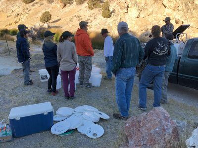image of small group of people receiving instruction for the fish plant.