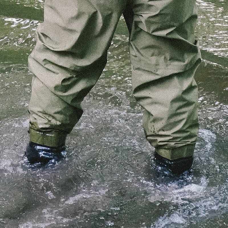 Close up of angler wading in stream