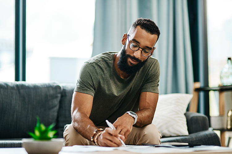 African american male writing in journal
