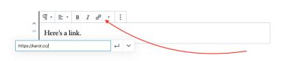 Flecha roja apuntando al símbolo de enlace