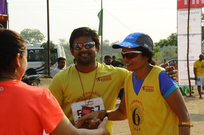 Friends greeting a runner at the finish