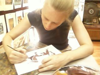 A tourist tries her hand at miniature painting