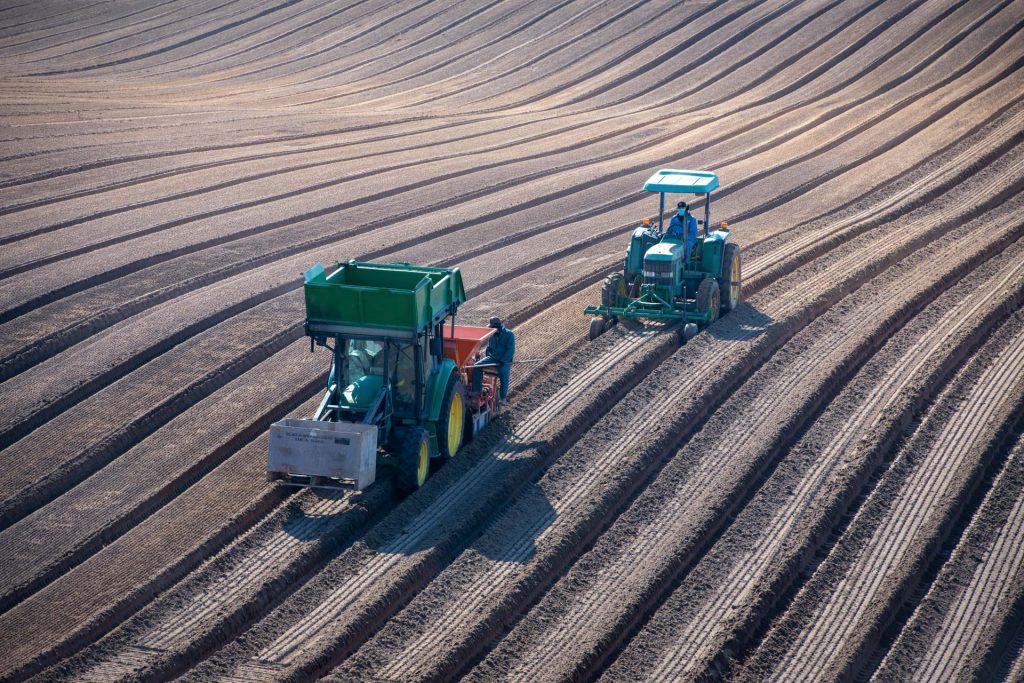 Two tractors planting Gladiola bulbs at Glad-A-Way Gardens in Santa Maria