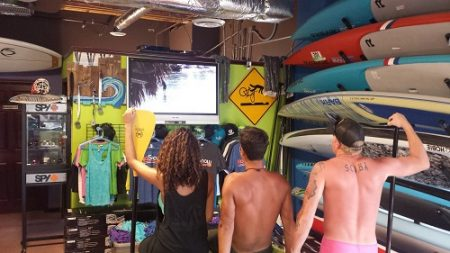 Watching intro to stand up paddle boarding
