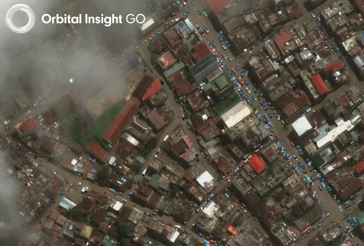 Detections of cars (blue dots) produced from Orbital Insight's Car Detector Algorithm