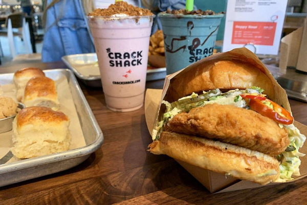 The Coop Deville sandwich at The Crack Shack, accompanied by a couple of decadent shakes and biscuits
