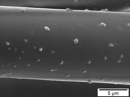 Silver antimicrobial treatment on fabric surface