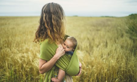 woman in the fields breastfeeding