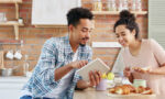 snack-the-right-way-couple-eating-snacks-looking-at-ipad