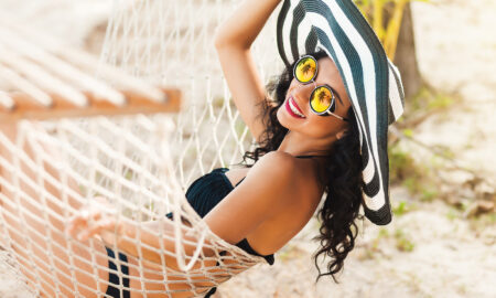 woman-on-the-beach-in-hammock-swimwear-sun-hat