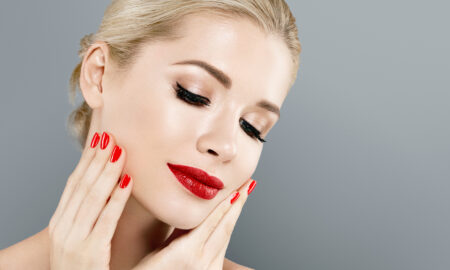 skincare-woman-with-red-nails-holding-face-red-lipstick-beauty-skin