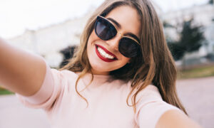 woman-in-sunglasses-with-red-lips-taking-selfie