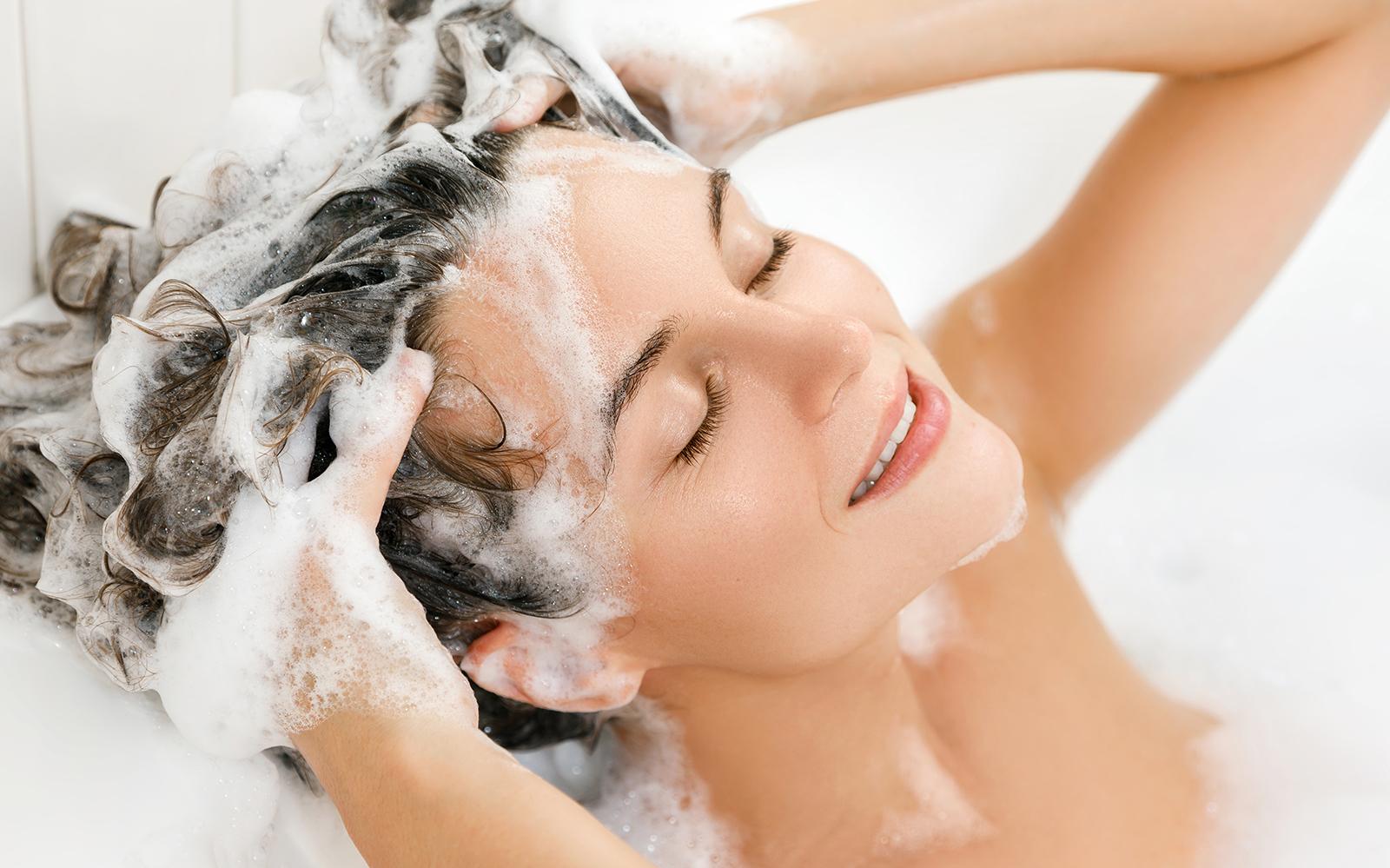 washing-hair-woman-washing-her-hair-and-enjoying-it