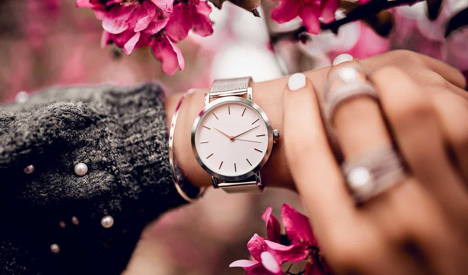 Beautiful silver watch on woman hand