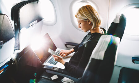 woman-working-while-on-an-airplane