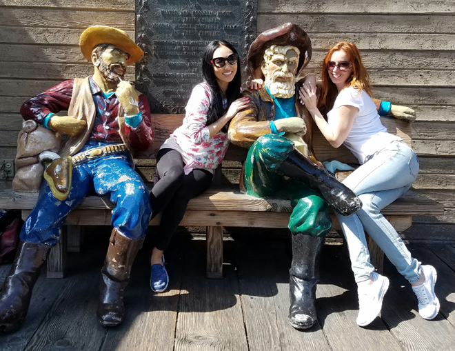 Candace Kita Gwendalyn Augustine hugging miners Knotts Berry Farm