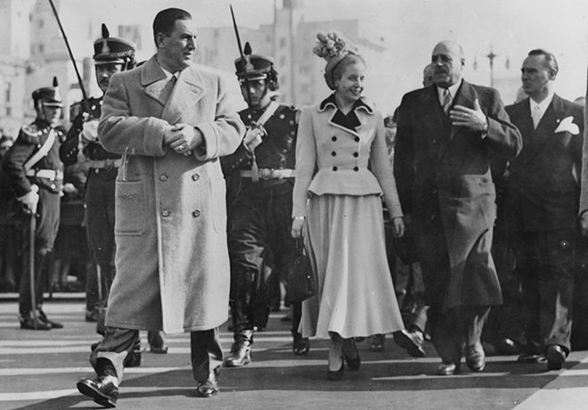 eva-peron-style-walking-with-juan-peron-in-power-suit