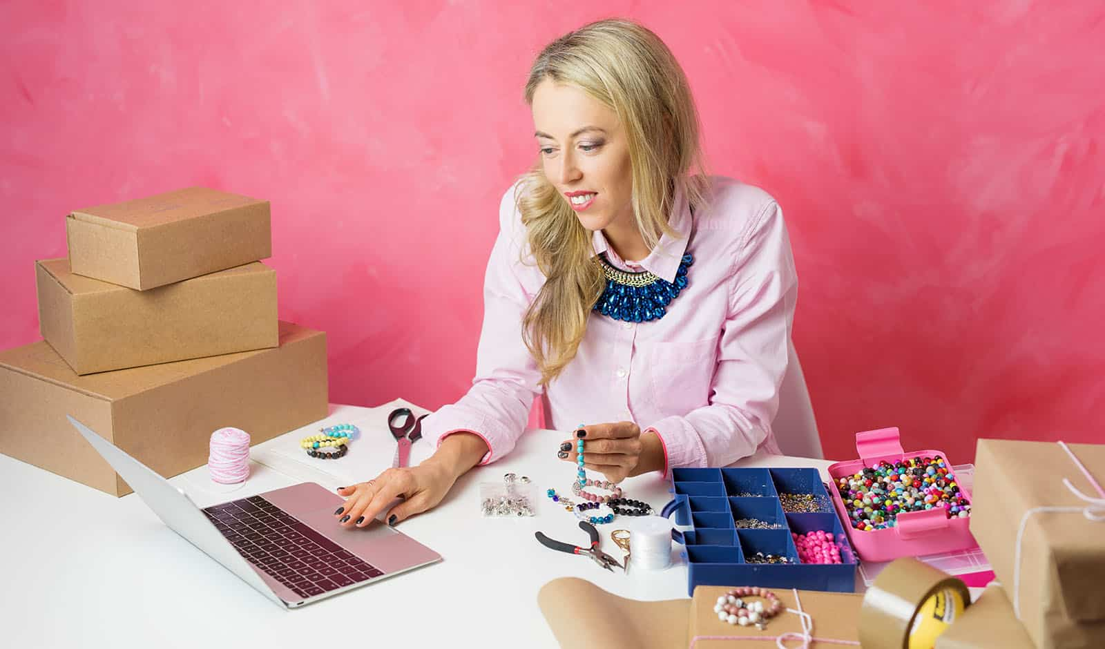 Woman working from home. Making pieces of jewellery and sells th