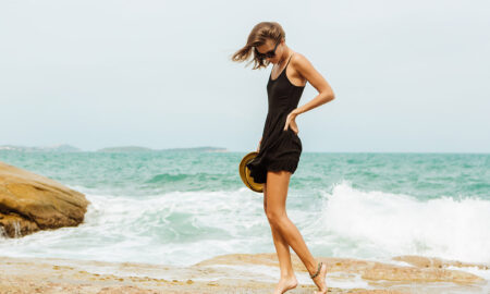 woman-walking-by-the-waves-on-the-beach
