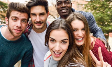 Group of multi-ethnic young people having fun together outdoors