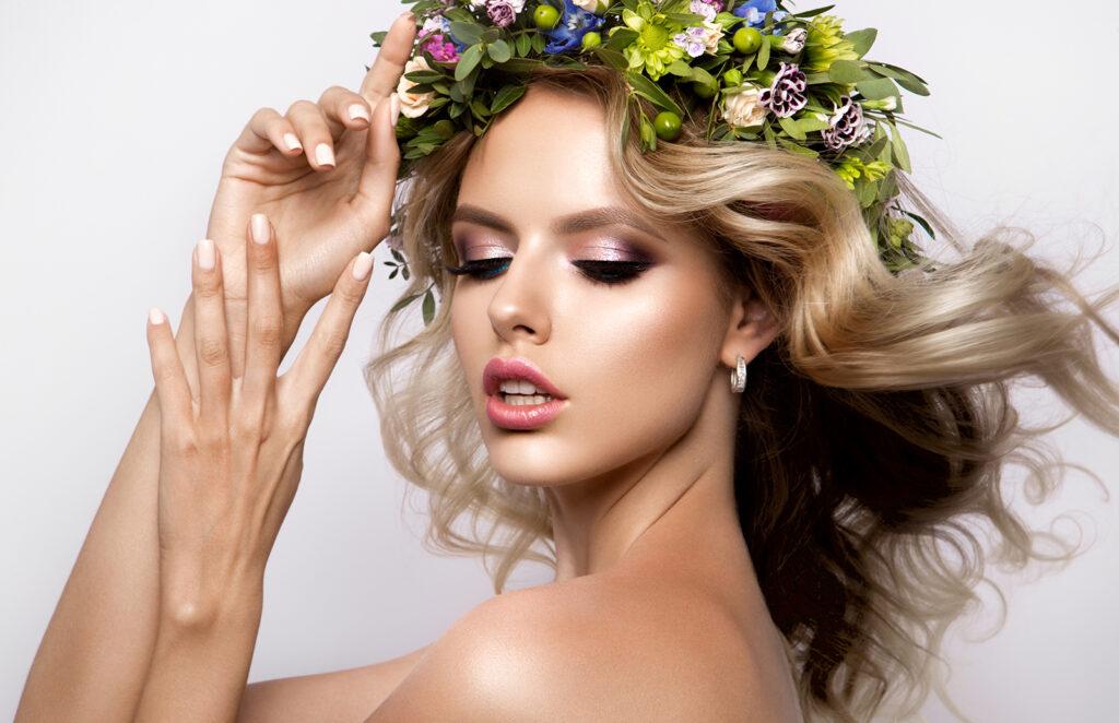 beauty-anti-aging-woman-in-flower-crown-looking-down-beautiful