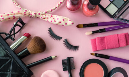 makeup-kit-makeup-items-laid-around-a-pink-background