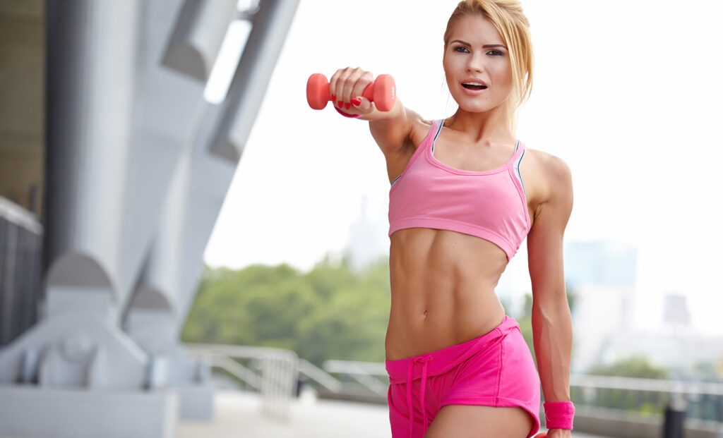 wellness-trends-girl-in-pink-outfit-working-out-muscle-fitness-health