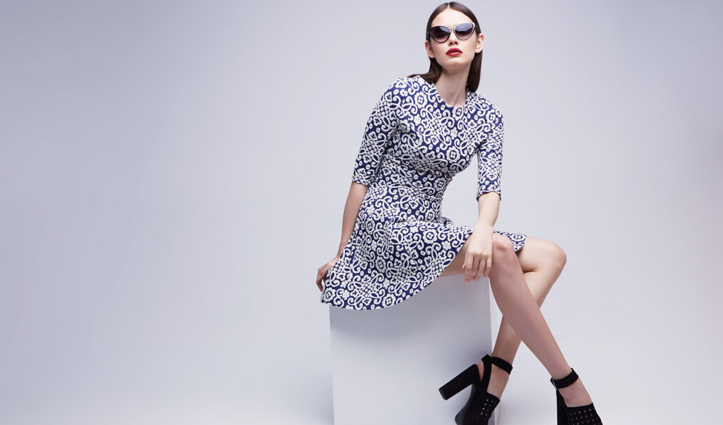 woman-sitting-in-fashionable-dress-sunglasses-and-heels