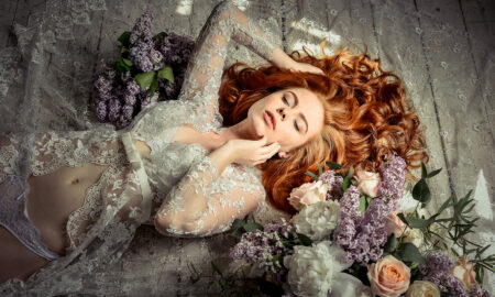woman-in-lingerie-laying-with-flowers