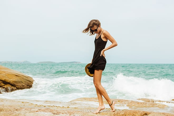 how-to-style-your-little-black-dress-casual-woman-on-the-beach-in-lbd