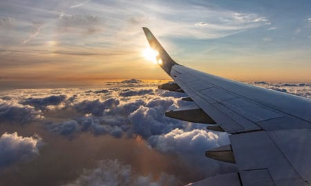tools-and-resources-to-help-you-plan-a-trip-view-from-plane-window-of-clouds