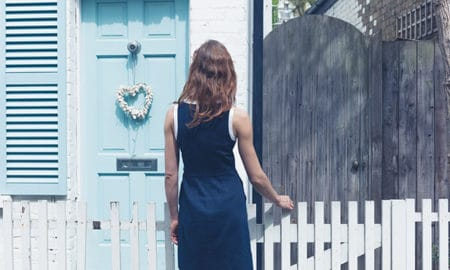 are-you-ready-to-buy-a-house-woman-staring-at-small-blue-home