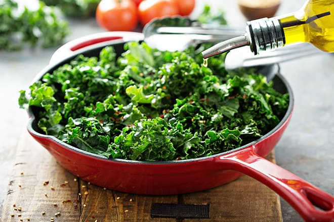 Antioxidant-Foods-You-Should-Include-in-Your-Diet-to-Stay-Healthy-Young-pan-of-kale-and-oil
