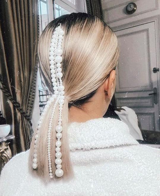 Glamorous Hair Looks That'll Get You Through Wedding Season pearl accessorized ponytail